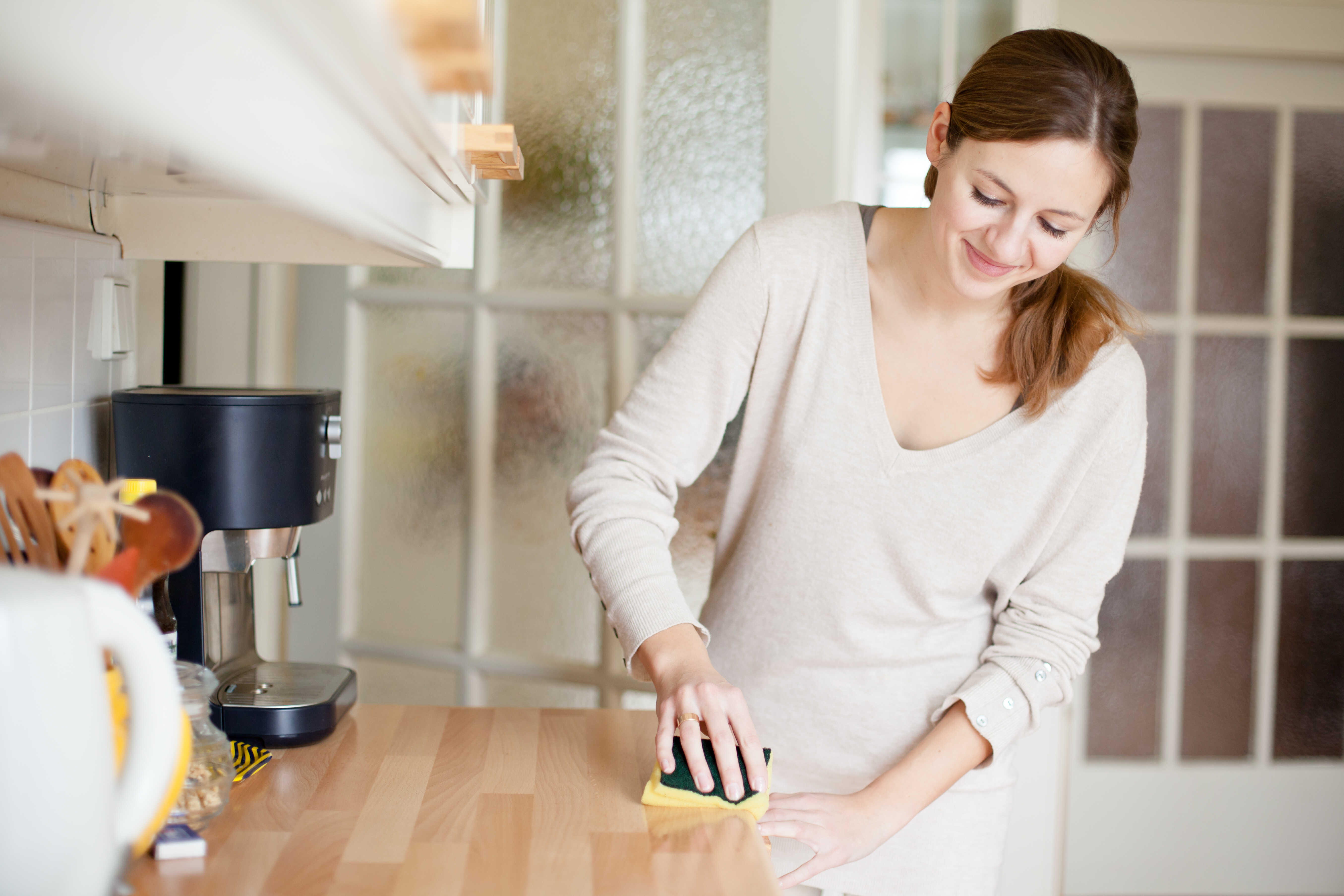 Woman wiping a countertop